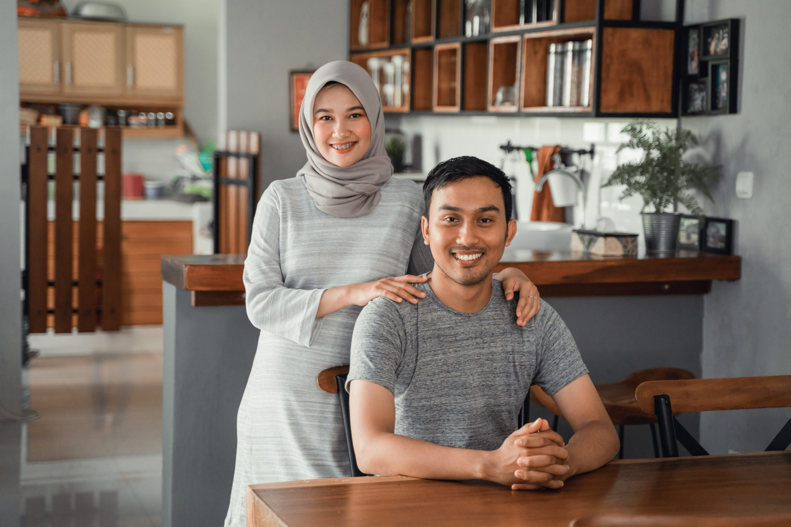 muslim-couple-sitting-dining-room-together-scaled.jpg